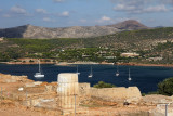 It's located on a cape (sounion, on Attica peninsula) and towers above the sea.