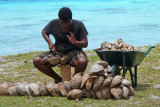 I passed a coconut seller hacking open coconuts