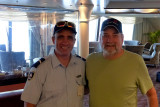 Howard with Pitcairn policeman from New Zealand. Howard bought a police patch for Al.