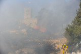 Firefighters prepare to extinguish fire as it spreads towards Scottish Church
