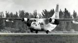 Late 1960's - Coast Guard Fairchild C-123B #CG-4705 lifting off from runway 27-R at Opa-locka Airport