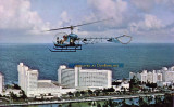 1970's - a postcard featuring a Bell 47 helicopter operated by Miami Helicopter Service owned by the Riggs families