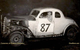 1950 - Robert Manning and his #87 in front of the fans at Opa-locka Speedway