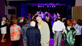 HHS-66 50-Year Reunion and Reunion of the 60's:  dancers in foreground and classmates singing on stage in the background