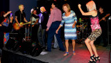 HHS-66 50-Year Reunion and Reunion of the 60's: classmates singing and dancing on stage with the band
