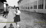 1961 - Mert Carroll, member of the ICS Girl Scout Club, in front of the portables at Immaculate Conception School