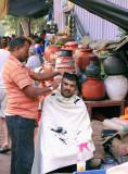 Sidewalk Barber, Mumbai, India.