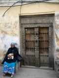 Woman and Door, Stonetown, Zanzibar, Tanzania.