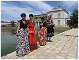 3 students and their teacher on a cultural trip