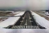 Final runway 7R, half fog-covered