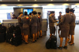 Asiana Airlines' flight attendants strive for a similar look with their uniforms & hair.