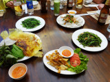 Shared dishes of food for lunch - Hanoi, Vietnam