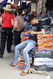 A teenager in the main market doing what teenagers from all over the world  typically do