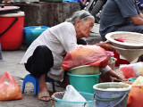 Woman near the main market - Hanoi, Vietnam