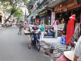 Worker with a heavy load near the main market - Hanoi, Vietnam