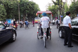 Hanoi's streets typically are busy with cars, various types of cycles and rickshaws  - seen while returning to the Aranya Hotel