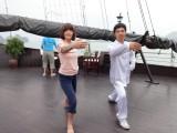 Judy learning T'ai Chi aboard the Treasure Junk in Ha Long Bay, Vietnam