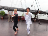 Janet learning T'ai Chi aboard the Treasure Junk in Ha Long Bay, Vietnam