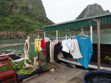 Clothing out to dry at a house in the floating village of Ha Long Bay, Vietnam