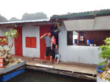 A father with his children - a house in the floating village of Ha Long Bay, Vietnam
