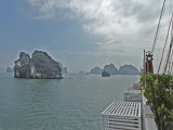 Eerily beautiful Ha Long Bay, Vietnam - part of our ship the Treasure Junk is in the foreground