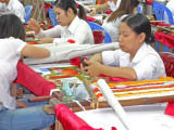 Artisans at a sheltered workshop employing disabled citizens - started after the Vietnam war with the U.S.
