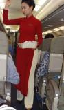 An elegant Vietnam Airlines' flight attendant - on our evening flight from Hanoi to Danang, Vietnam