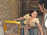 Obtaining silk to spin into thread - from the cocoons on the framework - Thang Loi Company, Hoi An, Vietnam