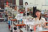Seamstresses preparing garments at the Thang Loi Company, Hoi An,Vietnam