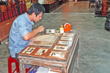 Another craftsman producing decorative pictures at the Thang Loi Company, Hoi An, Vietnam