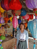 Judy among the beautiful and brightly colored silk lanterns produced at the Thang Loi Company, Hoi An, Vietnam