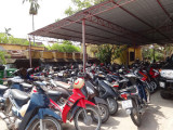 Parking lot of the Thang Loi Company showing scooters and motorcycles - common transportation in Vietnam -  Hoi An , Vietnam