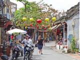 Silk lanterns hanging  across a street in Old Town  - Hoi An, Vietnam