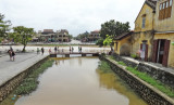 The Thu Bon River (background) and a canal (foreground) - Old Town, Hoi An, Vietnam