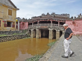Stan near the Japanese Bridge and a canal of the Thu Bon River - Old Town, Hoi An, Vietnam