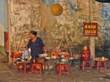 Outdoor restaurant - customers sit on the stools - Hoi An Vietnam