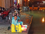 The Thu Bon River often floods (as shown here) - vendors (foreground) selling candles to float on the river - Hoi An, Vietnam