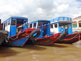 Boats on the My Tho River - used to transport tourists to nearby islands - My Tho, Mekong Delta, Vietnam