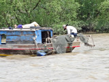 Fishermen on the My Tho River - photo taken while we were going by boat to a nearby island - Mekong Delta, Vietnam