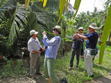 Sally and Stan - crafts lessons using large palm tree leaves - on an island near My Tho in the Mekong Delta, Vietnam