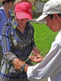 Janet - crafts lesson using a large palm tree leaf - on an island near My Tho in the Mekong Delta, Vietnam