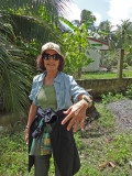 Judy showing the wrist band she made from a large palm tree leaf - on an island near My Tho in the Mekong Delta, Vietnam
