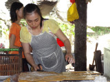 Making coconut candy - this worker cuts coconut candy 8 hours a day - on an island near My Tho in the Mekong Delta, Vietnam