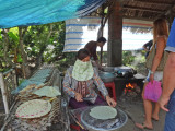 Making food wraps out of rice - on an island near My Tho in the Mekong Delta, Vietnam