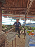 A worker involved in food preparation - on an island near My Tho in the Mekong Delta, Vietnam