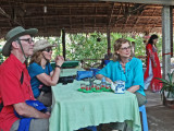 Fran, Stacy & Alan at a tea party (with fruit) while musicians played - on an island near My Tho in the Mekong Delta, Vietnam