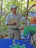 A musician at our tea party - on an island near My Tho in the Mekong Delta, Vietnam