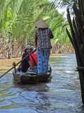 Our group in sampans exploring canals - an island near My Tho in the Mekong Delta, Vietnam