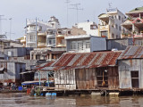 Village along the Mekong River - while leaving Chau Doc, Vietnam - on our way to Phnom Penh, Cambodia