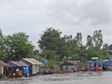 Floating village on the Mekong River - in Vietnam while traveling by boat from Chau Doc, Vietnam to Phnom Penh, Cambodia